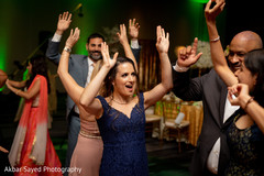Guests having a blast dancing during the reception