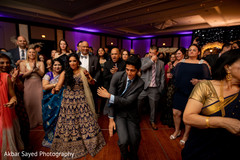 Fun capture of the guests enjoying the music at the reception
