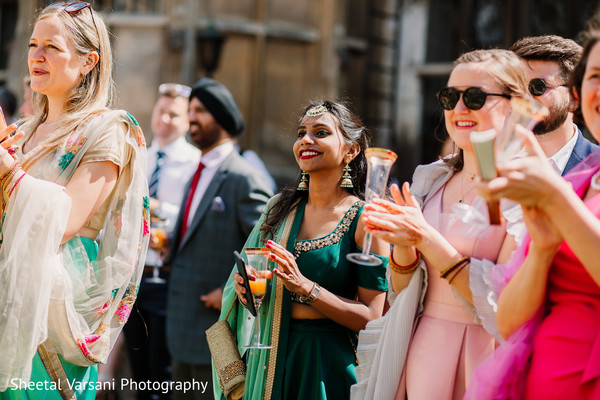 Dazzling guests cheer for the Indian newlyweds