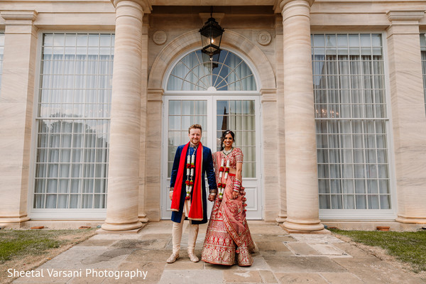 Indian newlyweds outside the venue posing for pictures