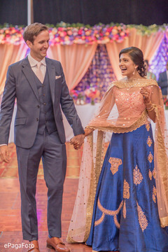 Elegant Indian bride and groom with wedding reception outfits.