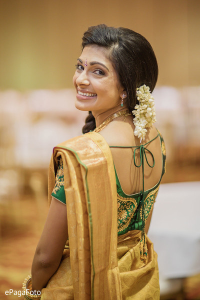 Stunning Indian bride with her wedding ceremony outfit.