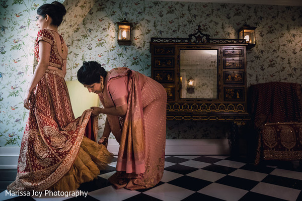 Maharani being assisted with her beautiful Sari by her mother
