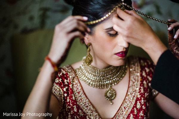 Indian bride wearing the traditional Tikka before the ceremony