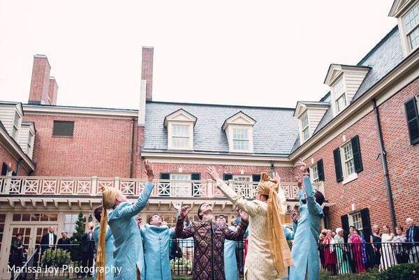 Cheerful Indian guests start with the fun baraat