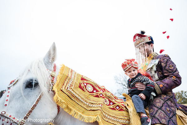 Lovely take of the Indian groom riding the ghodi during the baraat
