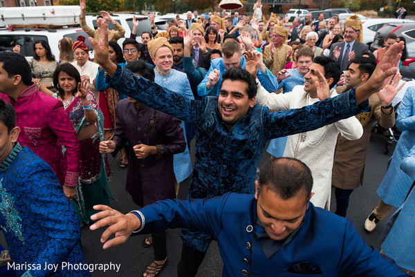 Joyful guests dancing during the fun baraat