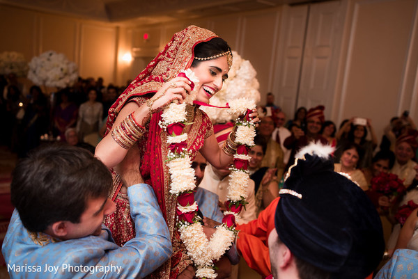 Beautiful maharani is lifted by guests during a moment of the ceremony