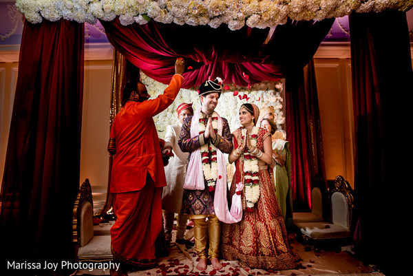 Indian newlyweds being blessed by the Hindu priest
