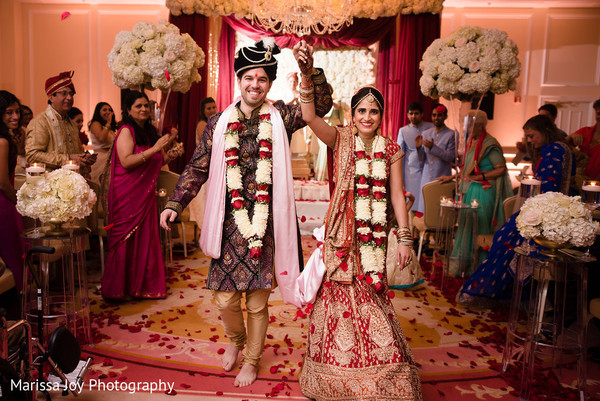 Joyful Indian newlyweds leave as the ceremony ends