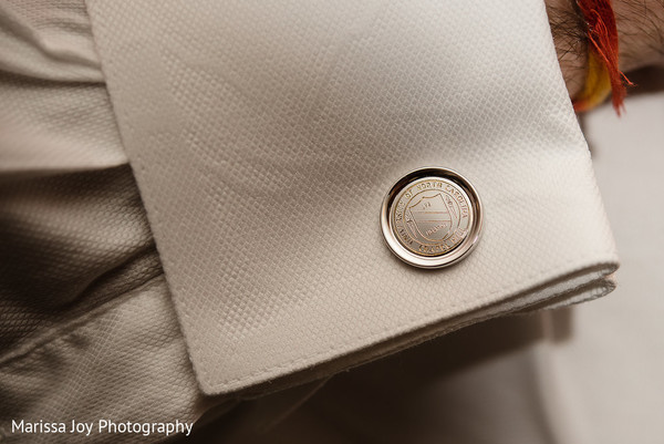 Close up details of the sherwani worn by the Indian groom