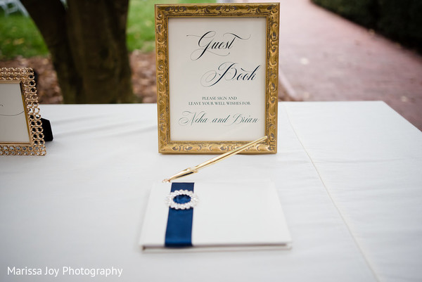 Shot of the lovely guest book at the Indian wedding reception