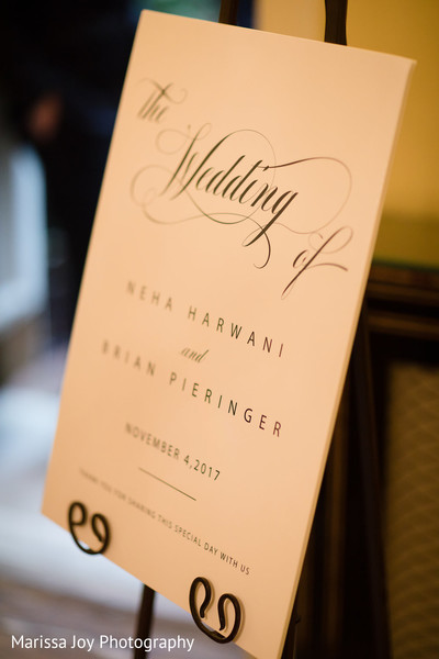 Sign welcoming the guests to the Indian wedding reception