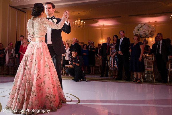 Lovely Indian couple having their first dance as guests observe