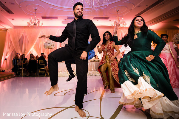 Special guests perform a choreography for the Indian couple