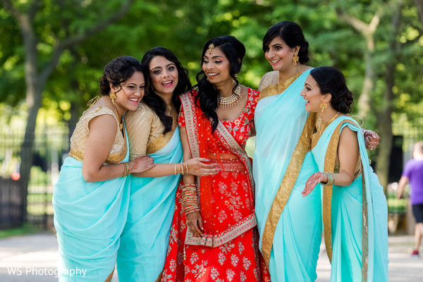 Indian bride and bridesmaids posing for photo.