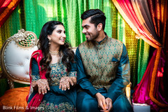Indian bride and groom during the mehndi celebration.