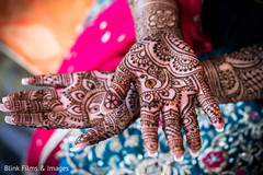 Gorgeous Indian bride hand mehndi art.