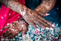 Indian bride with  traditional mehndi art.