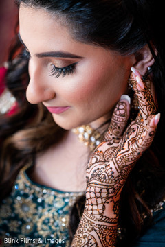 Lovely Indian bride with her mehndi art capture.