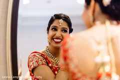 Capture of the beautiful Indian bride wearing the tikka