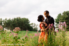 Amazing shot of the Indian couple on the flower fields
