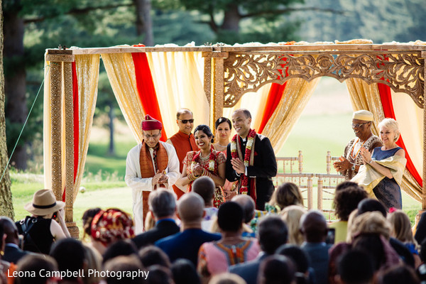 Guests and family cheer for the Indian newlyweds