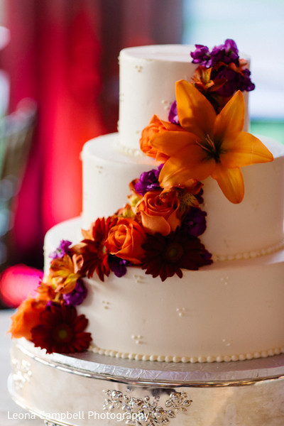 Close up detail of the delicious Indian wedding cake and flowers