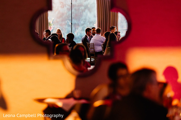 Great capture of the Indian wedding guests through a mirror