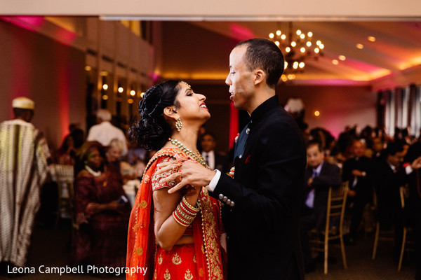 Indian newlyweds having their first dance as husband and wife