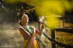 Joyful Indian bride posing outdoors.