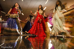 Lovely bridesmaids performing a sangeet dance.
