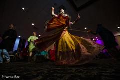 Great capture of Indian bride at pre-wedding celebration.