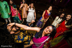 Indian pre-wedding guests celebrating with a dance.