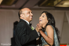 Lovely bride dancing with father.