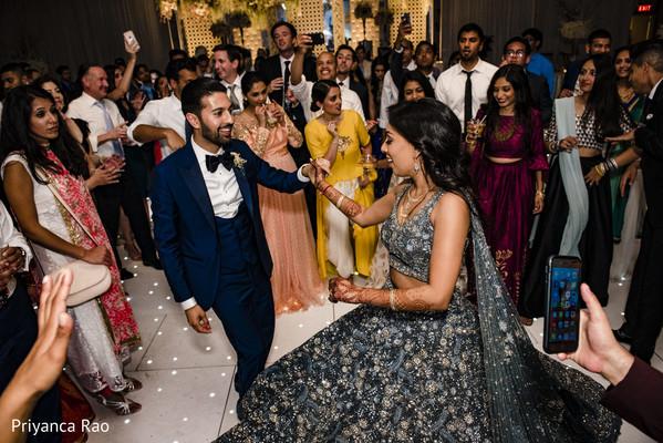 Cheerful Indian wedding reception dance.