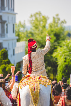 Capture of the fun baraat outdoors heading to the venue