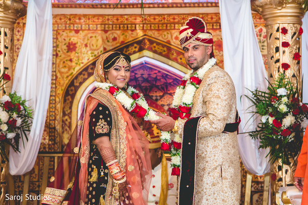 Indian newlyweds pose with the flower garlands