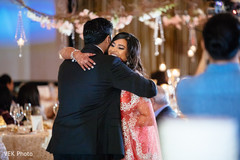 Gorgeous Indian bride  and groom hugging capture.