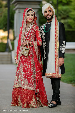 Elegant indian bride and groom posing for photo shoot