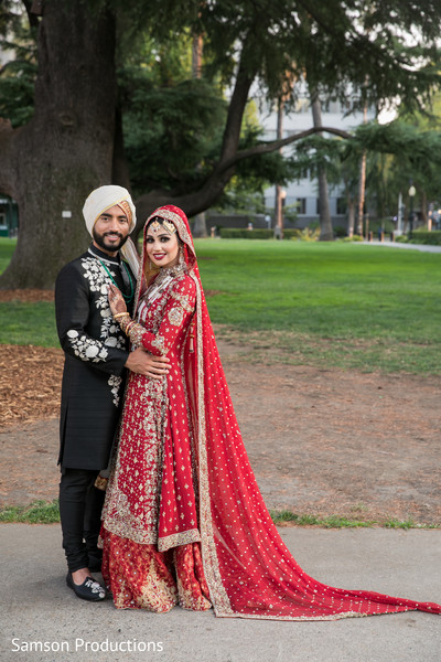 Adorable indian bride posing with groom