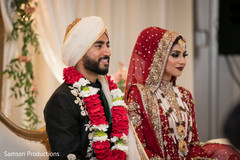 Lovely indian couple at their wedding stage