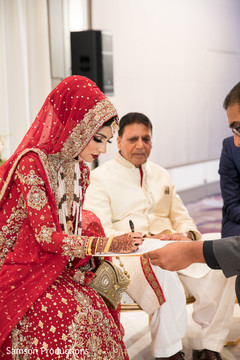 Indian bride signing her marriage contract