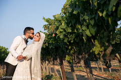 Beautiful indian newlyweds outdoor capture