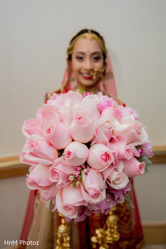Lovely indian bride showing her floral bouquet