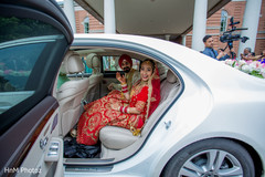 Indian bride and groom ready to leave the ceremony
