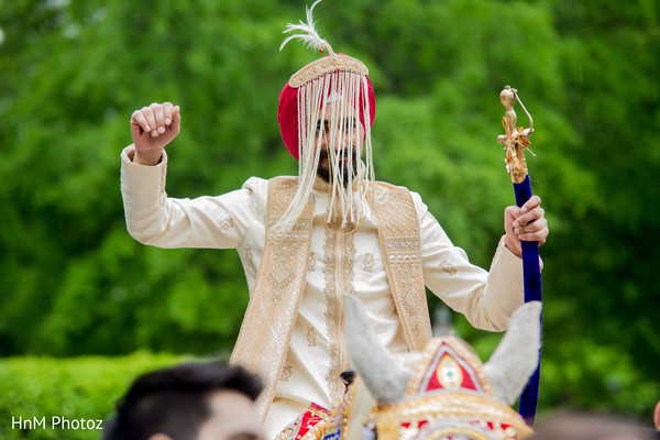 Indian groom enjoying baraat
