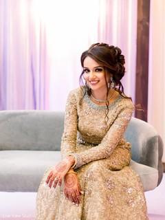 Indian bride showing her dazzling mehndi design