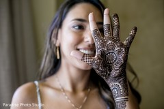 Beautiful Indian bride showing her mehndi design