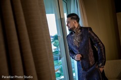 Charming Indian groom getting ready scene